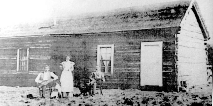 Butch Cassidy, Etta Place and the Sundance Kid (right to left) in front of their ranch cabin in Cholila, Argentina, sometime between 1901-1905.